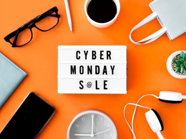 Flat lay of cyber monday light box with shopping bag and coffee