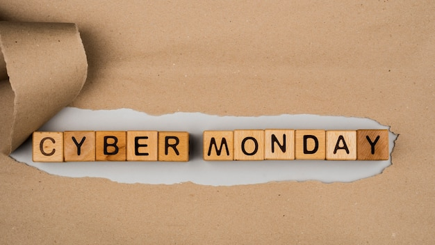 Flat lay of cyber monday word on craft paper