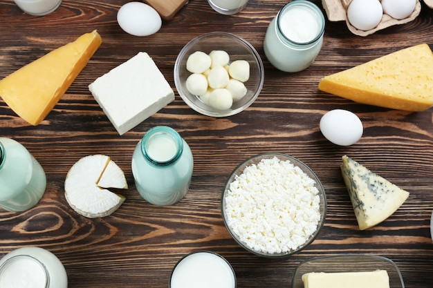 Flat lay of dairy products on wooden background
