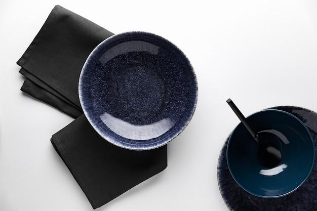 Flat lay of dark dinnerware