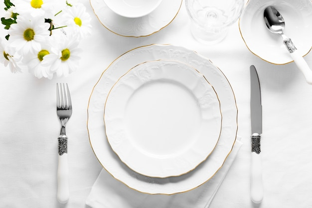 Flat lay decoration white plates