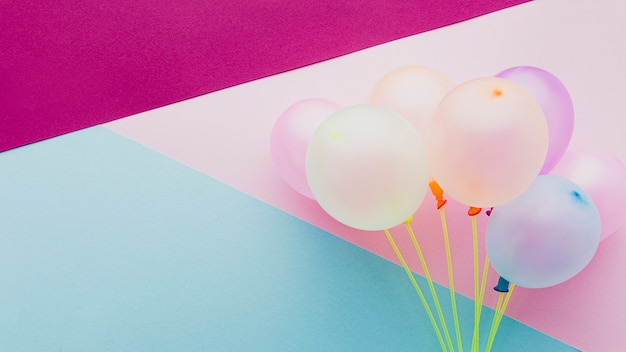 Flat lay decoration with balloons and colorful background
