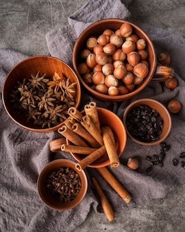 Flat lay decoration with cinnamon sticks and hazelnuts
