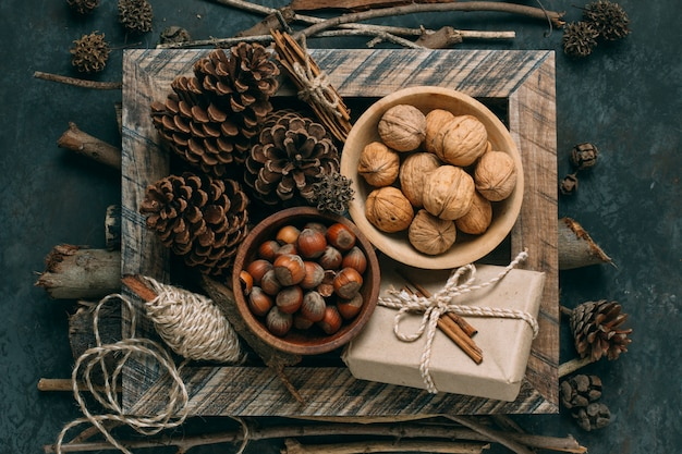 Flat lay decoration with nuts and pine cones