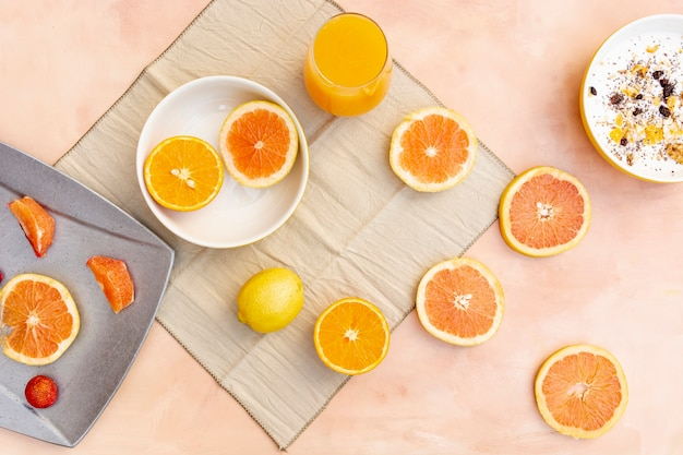 Flat lay decoration with orange and lemon slices