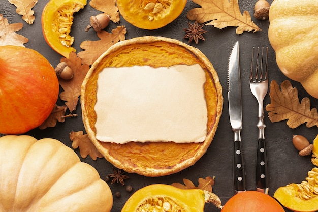 Flat lay decoration with pumpkins and pie