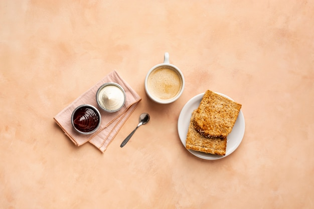 Flat lay decoration with toast and cappuccino
