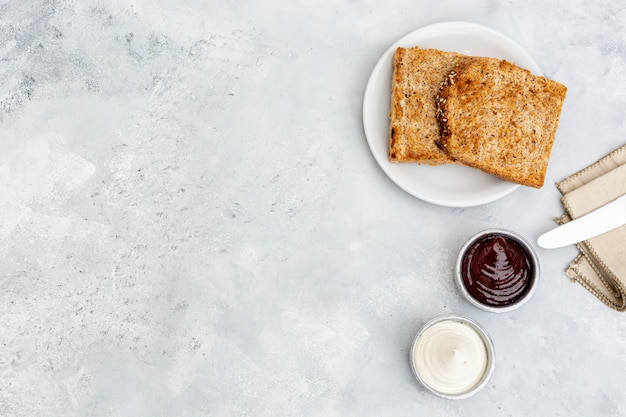 Flat lay decoration with toast and sauces