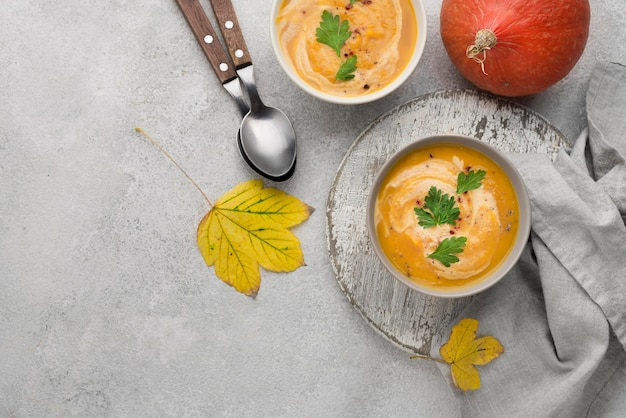 Flat lay delicious autumn soup composition on white background