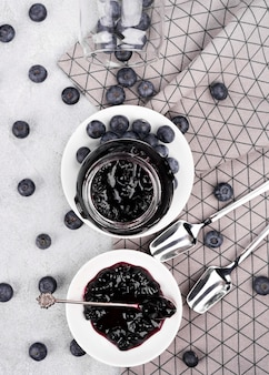 Flat lay delicious blueberry jam