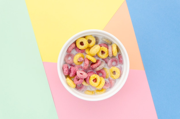Flat lay delicious bowl of fruit cereal loops