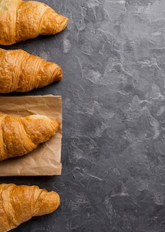 Flat lay delicious croissants and copy space