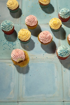 Flat lay delicious cupcakes arrangement