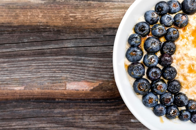 Flat lay delicious fresh blueberries on plate