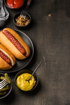 Flat lay delicious hot dogs on plate