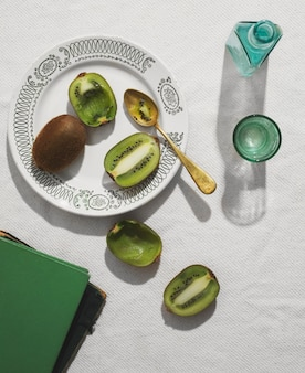 Flat lay delicious kiwi on plate