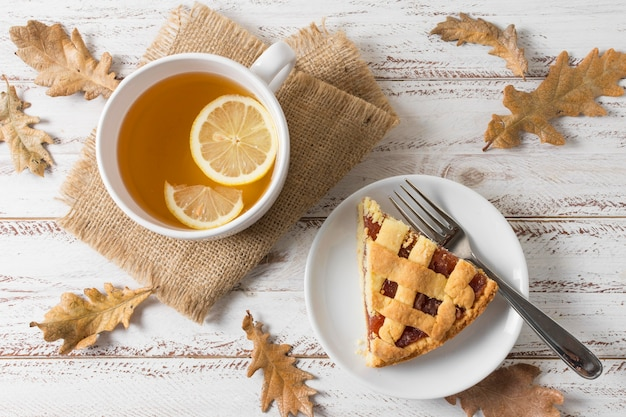 Flat lay delicious pie slice and tea cup