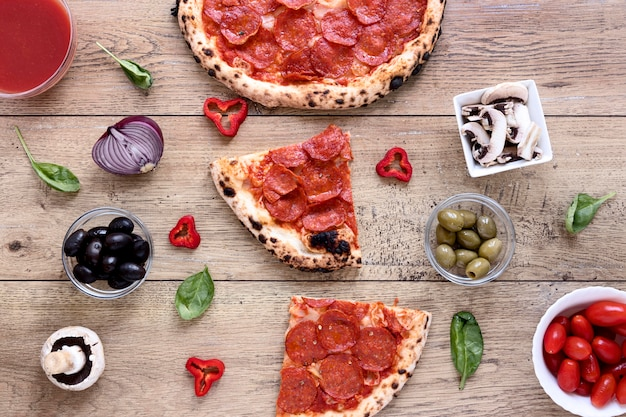 Flat lay delicious pizza on wooden background