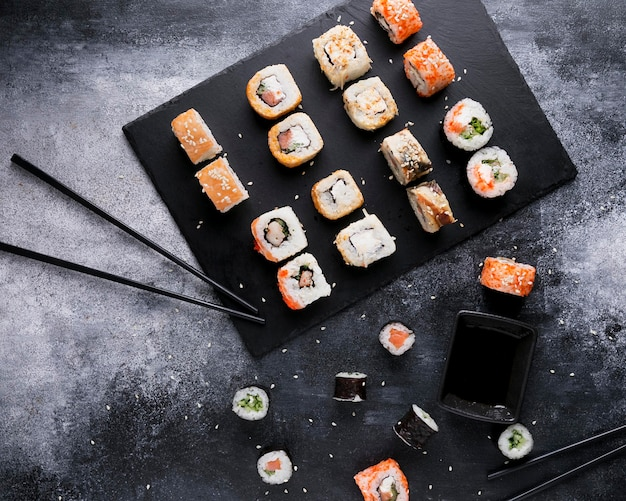 Flat lay delicious sushi and sauce