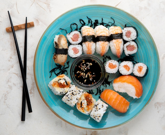 Flat lay of delicious sushi with copy space