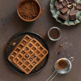 Flat lay of delicious waffers breakfast