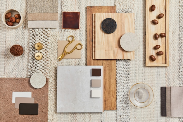 Flat lay design of creative architect moodboard composition with samples of building, beige textile and natural materials and personal accessories. top view, template.
