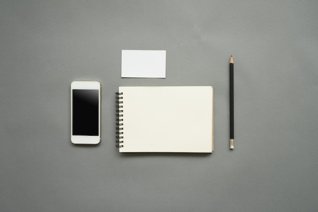 Flat lay design of work desk with blank notebook