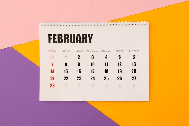 Flat lay desk calendar on colourful background