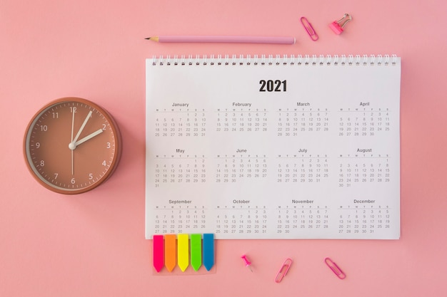Flat lay desk calendar on pink background
