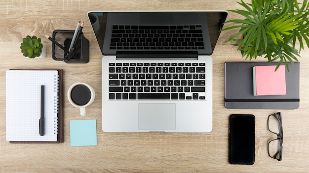 Flat lay of desk concept with laptop