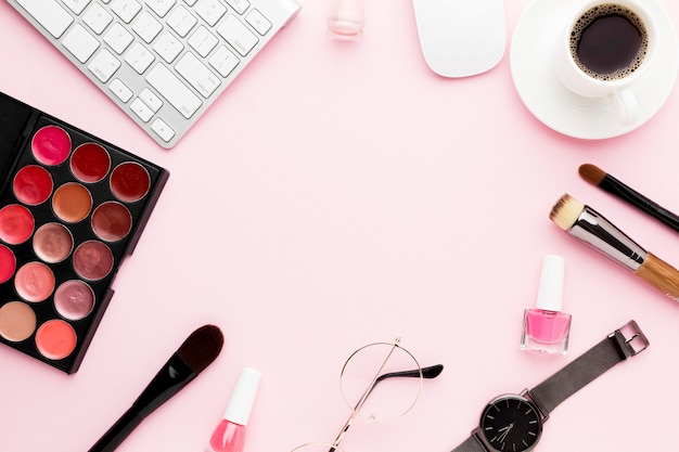 Flat lay desk items on pink background