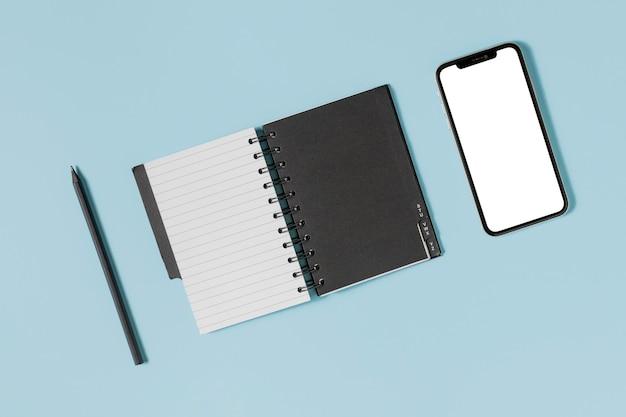 Flat lay desk minimal black and white agenda