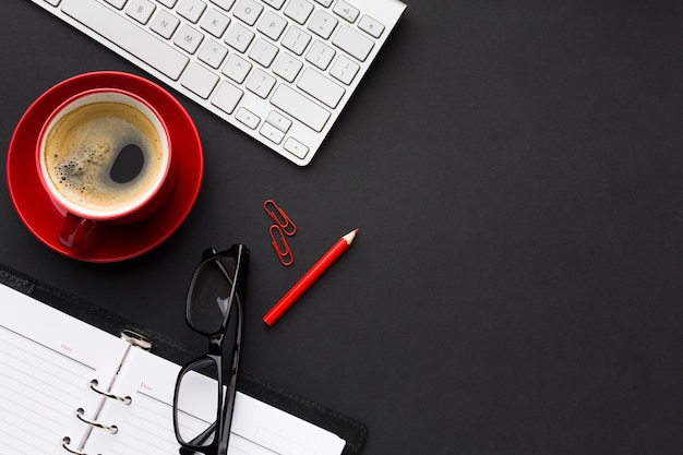 Flat lay of desk with coffee and copy space