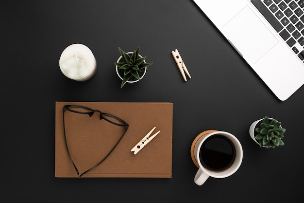 Flat lay of desktop with agenda and glasses on top