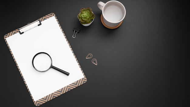 Flat lay of desktop with magnifier and copy space