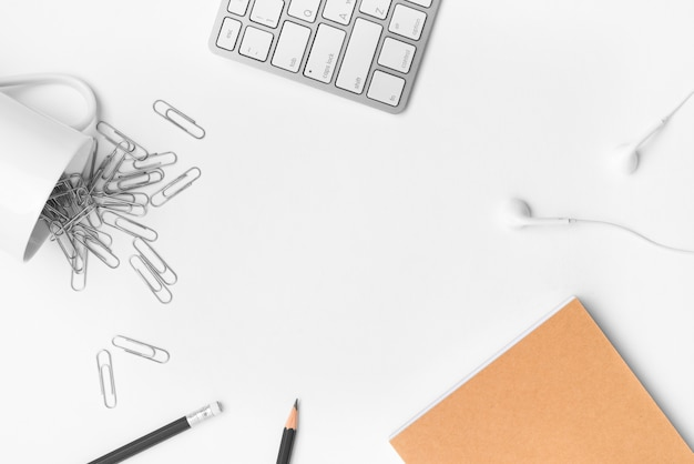 Flat lay of desktop workspace accessories with copy space on white background