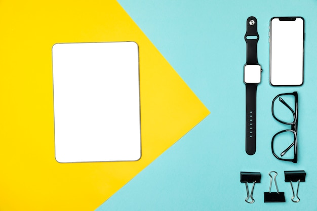 Flat lay devices on colourful background