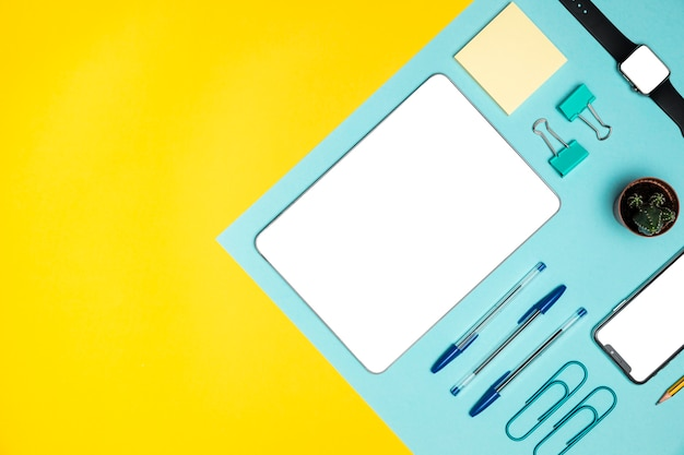 Flat lay devices with office supplies