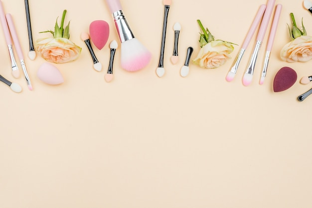 Flat lay different beauty products arrangement with copy space