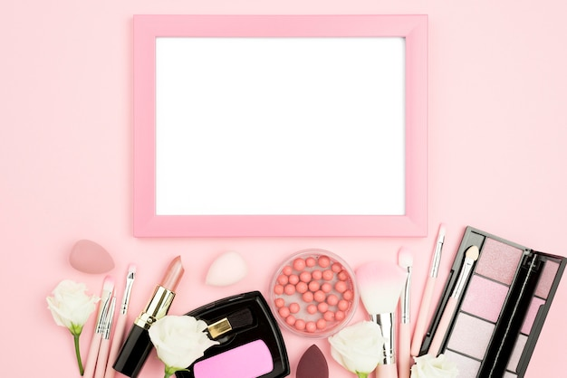 Flat lay different beauty products assortment with empty frame