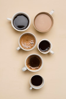 Flat lay different cups of coffee arrangement