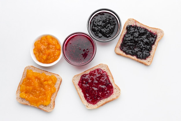 Flat lay different types of jam