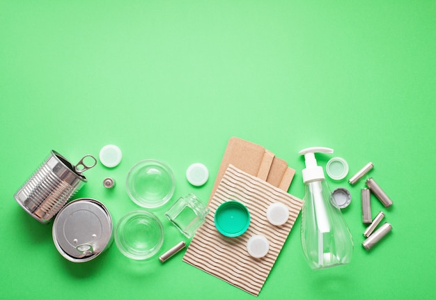 Flat lay of different wastes wastes ready for recycling. plastic, glass, paper, tin cans