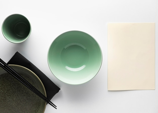 Flat lay of dinnerware with chopsticks bowl