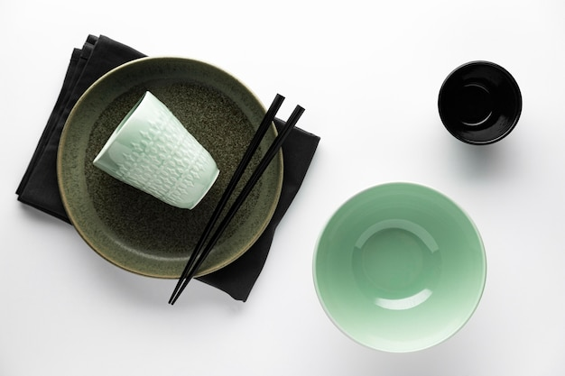 Flat lay of dinnerware with chopsticks and bowl