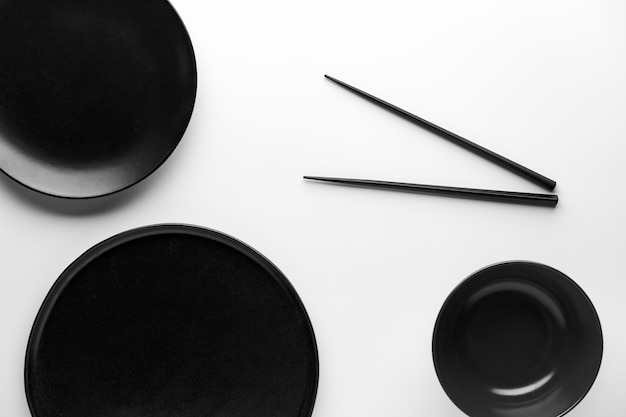 Flat lay of dinnerware with chopsticks