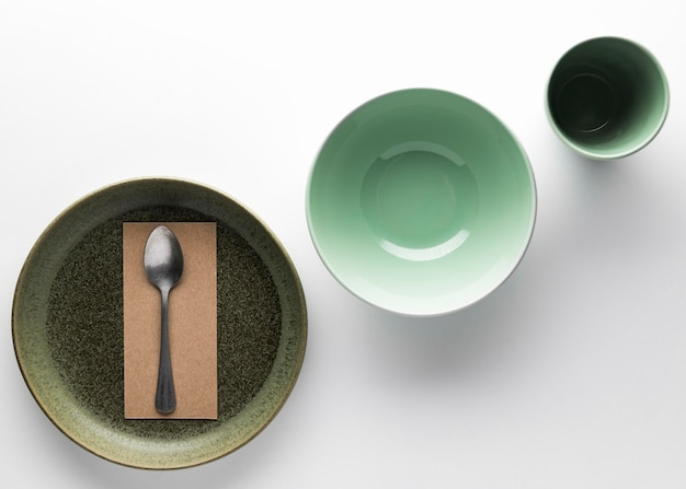 Flat lay of dinnerware with silver spoon