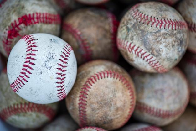 Flat lay of dirty baseballs