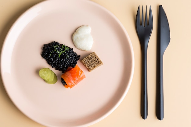 Flat lay dish with caviar