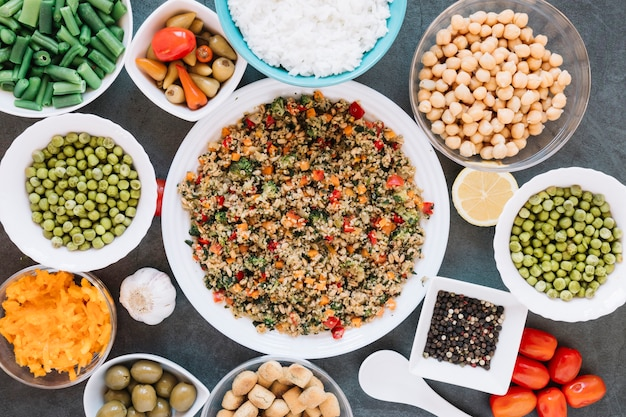 Flat lay of dishes with chickpeas and black pepper